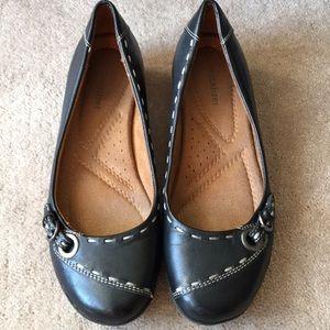 Naturalizer black slip ons loafers.